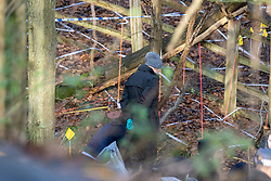 "© Licensed to London News Pictures. 11/12/2019. Gerrards Cross, UK. Forensic investigators look over the search area in Gerrards Cross, Buckinghamshire as the Metropolitan Police Service continue to search woodland. Police have been in the area conducting operations since Thursday 5th December 2019. In a press statement issued on 7th December, a Metropolitan Police spokesperson said ""Officers are currently in the Gerrards Cross area of Buckinghamshire as part of an ongoing investigation.<br /> ""We are not prepared to discuss further for operational reasons."" Photo credit: Peter Manning/LNP"