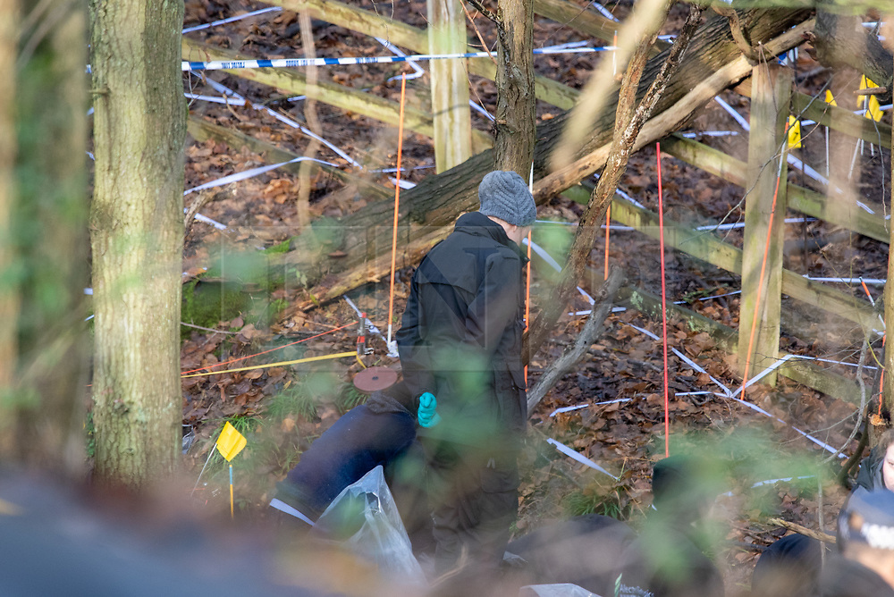 """© Licensed to London News Pictures. 11/12/2019. Gerrards Cross, UK. Forensic investigators look over the search area in Gerrards Cross, Buckinghamshire as the Metropolitan Police Service continue to search woodland. Police have been in the area conducting operations since Thursday 5th December 2019. In a press statement issued on 7th December, a Metropolitan Police spokesperson said """"Officers are currently in the Gerrards Cross area of Buckinghamshire as part of an ongoing investigation.<br /> """"We are not prepared to discuss further for operational reasons."""" Photo credit: Peter Manning/LNP"""