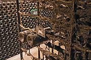 old bottles in the cellar domaine comte senard aloxe-corton cote de beaune burgundy france