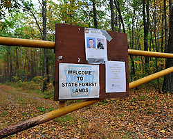 A wanted poster for Eric Frein hangs on a access gate  at the Delaware State Forest. Police continue to search the heavily wooded terrain for fugitive Eric Matthew Frein on Oct. 3, 2014, near Canadensis, Pa. (Chris Post | lehighvalleylive.com)