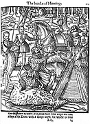 Elizabeth I (1533-1603) on the hunting field alights to perform the ceremony of assaying the stag, and is handed the knife by the huntsman. From George Turbevile or Turbeville 'The Noble Art of Venerie' 1576. Woodcut.