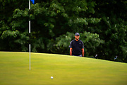 Tiger Woods reacts to his third shot on the ninth hole during the third round of the BMW Championship golf tournament at Aronimink Golf Course in Newtown Square, Pennsylvania on September 8, 2018.