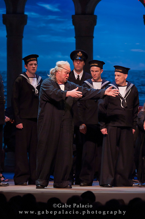 Scott Bearden, baritone,in the role of Dick Deadeye, with the Caramoor Festival Chorus during the performance of HMS Pinafore, a Bel Canto at Caramoor performance in the Venetian Theater of Caramoor in Katonah New York..photo by Gabe Palacio
