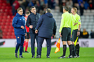 Sunderland AFC manager, Jack Ross speaks with referee Lee Probert after the final whistle of the EFL Sky Bet League 1 match between Sunderland AFC and Luton Town at the Stadium Of Light, Sunderland, England on 12 January 2019.