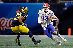 Florida Gators quarterback Feleipe Franks #13 runs the ball during the Chick-fil-A Peach Bowl, Saturday, December 29, 2018, in Atlanta. ( Paul Abell via Abell Images for Chick-fil-A Peach Bowl)