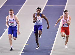 Great Britain's Ojie Edoburun (centre) running in the second semi-final of the Men's 60m during day two of the European Indoor Athletics Championships at the Emirates Arena, Glasgow.