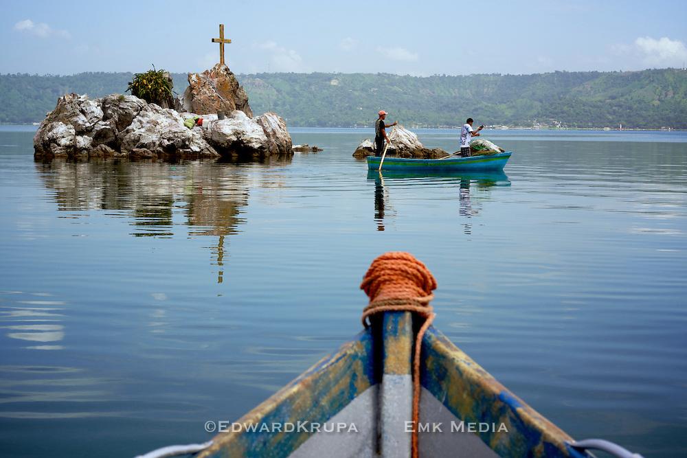 Fishermen on Lake Ilopango,   a crater lake that fills a volcanic caldera in central El Salvador.
