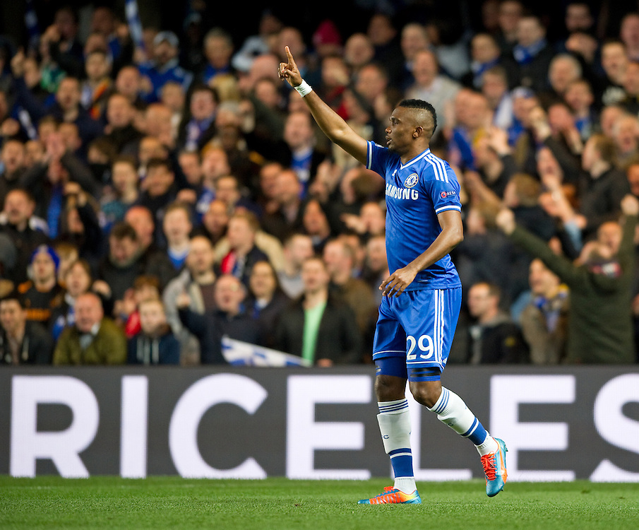 Chelsea's Samuel Eto'o celebrates scoring his sides first goal against Galatasaray<br /> <br /> Photo by Ashley Western/CameraSport<br /> <br /> Football - UEFA Champions League First Knockout Round 2nd Leg - Chelsea v Galatasaray - Tuesday 18th March 2014 - Stamford Bridge - London<br />  <br /> © CameraSport - 43 Linden Ave. Countesthorpe. Leicester. England. LE8 5PG - Tel: +44 (0) 116 277 4147 - admin@camerasport.com - www.camerasport.com