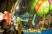 New York, NY – 27 November 2019. Thousands of spectators packed the streets around the American Museum of Natural History to see the inflation area for the balloons for Macy's Thanksgiving Day Parade. The Trolls were a popular subject for photography.