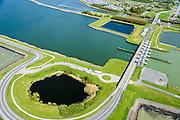 Nederland, Flevoland, Lelystad, 07-05-2015. Oostvaardersdijk, Houtribsluizen en begin van de Houtribdijk.<br /> Oostvaardersdijk, Houtrib locks and beginning of the Houtrib dike.<br /> luchtfoto (toeslag op standard tarieven);<br /> aerial photo (additional fee required);<br /> copyright foto/photo Siebe Swart