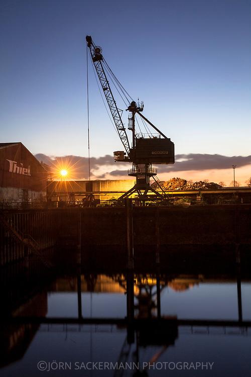 crane in the Rhine harbor in the district Deutz, Cologne, Germany.<br /> <br /> Verladekran im Deutzer Hafen, Koeln, Deutschland.