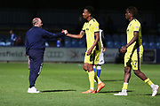 Gary Johnson and goal scorer Manny Duku at the final whistle during the EFL Sky Bet League 2 match between Macclesfield Town and Cheltenham Town at Moss Rose, Macclesfield, United Kingdom on 21 August 2018.