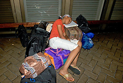 30 August, 2005. New Orleans, Louisiana.  Hurricane Katrina aftermath. <br /> A young girl awaits evacuation from the Hyatt hotel in New Orleans.<br /> Photo Credit: Charlie Varley/varleypix.com