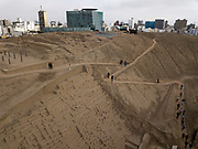 """In this Oct. 6 2017 photo, tourists walk the trails of the pre-Columbian archeological site Pucllana, surrounded by modern high-rises in the Miraflores district of Lima, Peru. Peruvians have lived their entire lives alongside the """"huacas,"""" an indigenous Quechua word meaning """"oracle"""" or """"sacred place."""""""