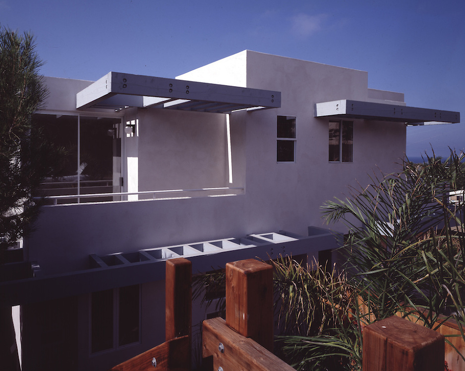 A duplex on a very steep lot, I used the trellis to break up the facade facing the street.  I was responsible for all aspects of the Design, Construction Documents and Administration.