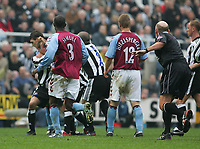Photo. Andrew Unwin, Digitalsport<br /> Newcastle United v Aston Villa, Barclays Premiership, St James' Park, Newcastle upon Tyne 02/04/2005.<br /> Newcastle's Lee Bowyer (L) is restrained by Aaron Hughes as he fights with his team-mate, Kieron Dyer