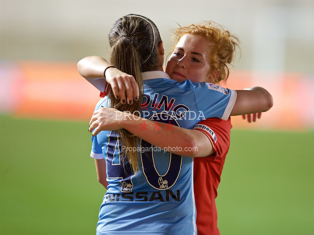 MANCHESTER, ENGLAND - Thursday, September 10, 2015: Liverpool Ladies' Martha Harris embraces Manchester City Women's Natasha Harding after the FA Women's Super League match at the Academy Stadium. (Pic by David Rawcliffe/Propaganda)