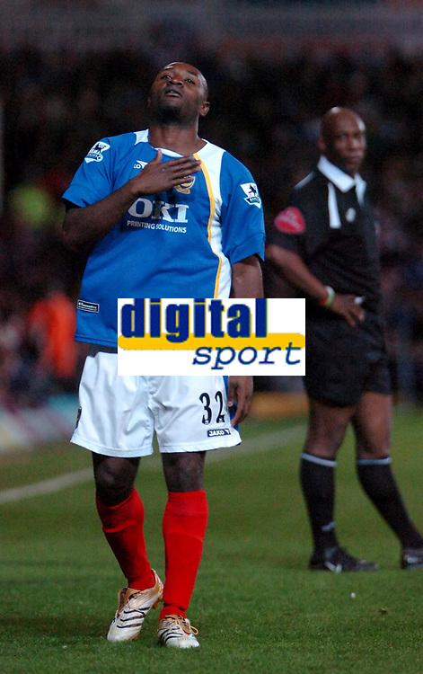 Photo: Ed Godden.<br />Portsmouth v Arsenal. The Barclays Premiership. 12/04/2006. Lomana Lua Lua celebrates scoring for Pompey.
