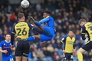 Kgosi Nthle flies high during the EFL Sky Bet League 1 match between Rochdale and Scunthorpe United at Spotland, Rochdale, England on 23 March 2019.