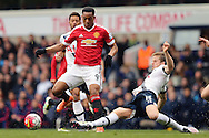 Eric Dier of Tottenham Hotspur ® tackles Anthony Martial of Manchester United. Barclays Premier league match, Tottenham Hotspur v Manchester Utd at White Hart Lane in London on Sunday 10th April 2016.<br /> pic by John Patrick Fletcher, Andrew Orchard sports photography.