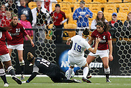 04 December 2011: Stanford's Emily Oliver (19, black) and Alina Garciamendez (4) defend against Duke's Kim DeCesare (19, white). The Stanford University Cardinal defeated the Duke University Blue Devils 1-0 at KSU Soccer Stadium in Kennesaw, Georgia in the NCAA Division I Women's Soccer College Cup Final.