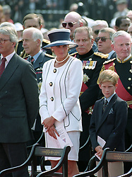 The Prince of Wales and Princess of Wales, with sons Prince Harry (l) and Prince William on the podium for the VJ Commemorations at Buckingham Palace.
