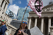 Environmental activists protest at Bank in the City of London on the 11th and final day of protests, road-blockages and arrests across London by the climate change campaign Extinction Rebellion, on 25th April 2019, in London, England.