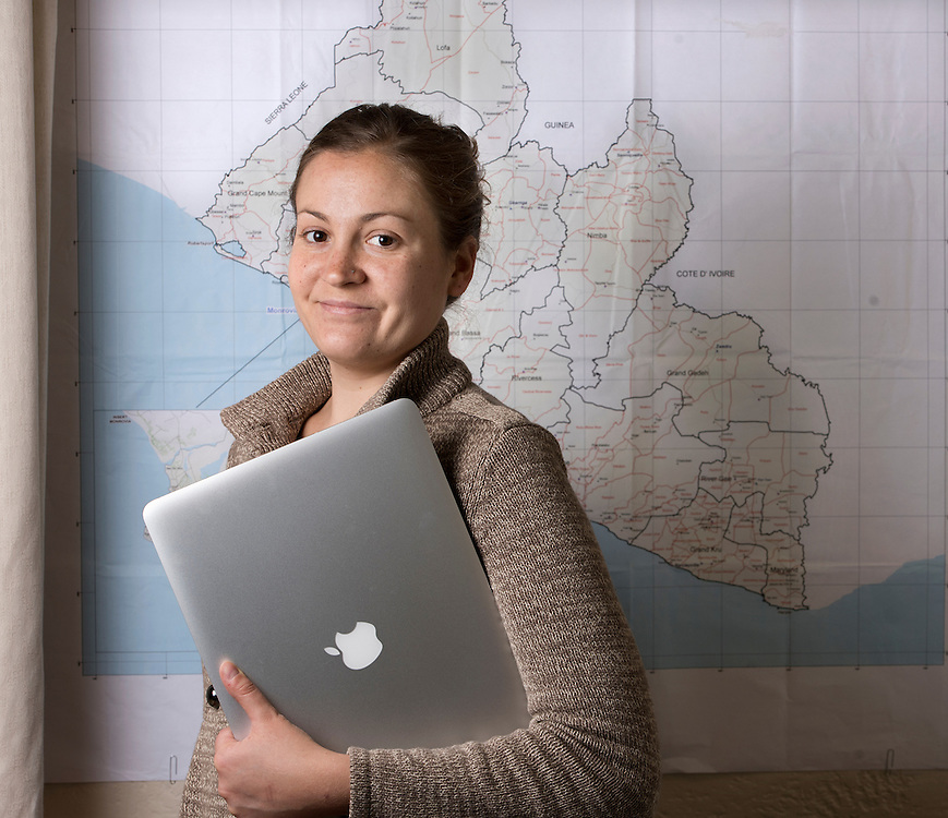 Mara Lavitt <br /> March 10, 2016<br /> Yale School of Public Health graduate student Laura Skrip in the Sterling Memorial Library Map Department in front of a map of Liberia.