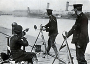 British marines practicing sending and receiving signals by heliograph.