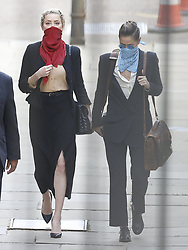 © Licensed to London News Pictures. 22/07/2020. London, UK. American actor AMBER HEARD (R) arrives with Bianca Butti at the High Court in London where Johnny Depp is in a legal dispute with UK tabloid newspaper The Sun over allegations he assaulted his former wife, Amber Heard. Photo credit: Peter Macdiarmid/LNP
