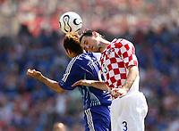 Photo: Chris Ratcliffe.<br /> Japan v Croatia. Group F, FIFA World Cup 2006. 18/06/2006.<br /> Josip Simunic of Croatia clashes with Naohiro Takahara of Japan.