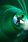 Price Chambers / JACKSON HOLE DAILY.Charlie Hoelscher, 2 attempts a treacherous climb inside the slide at Miller Park on Monday. The youngster got his parents to bring him outside to enjoy the unusually fair weather.