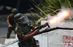 Members of the National Guard fire tear gas at anti-government demonstrators after an  opposition march  to demand that President Chavez  submit to a recall referendum turned violent.  The march was held on the first day of the G15 summit in Caracas.