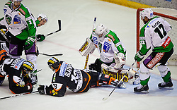 14.10.2011, Eisstadion Liebenau, Graz, AUT, EBEL, Graz 99ers vs Olimpija Ljubljana, im Bild Jean Philippe Lamoureux, (Olimpija Ljubljana, #1), Zdenek Blatny, (99ers, #13), Cole Jarrett, (99ers, #2) // during the ice hockey game between Graz 99ers and Olimpija Ljubljana at the Eisstadion Liebenau, Graz, Austria, 2011/10/14, EXPA Pictures © 2011, PhotoCredit: EXPA/ S. Zangrando