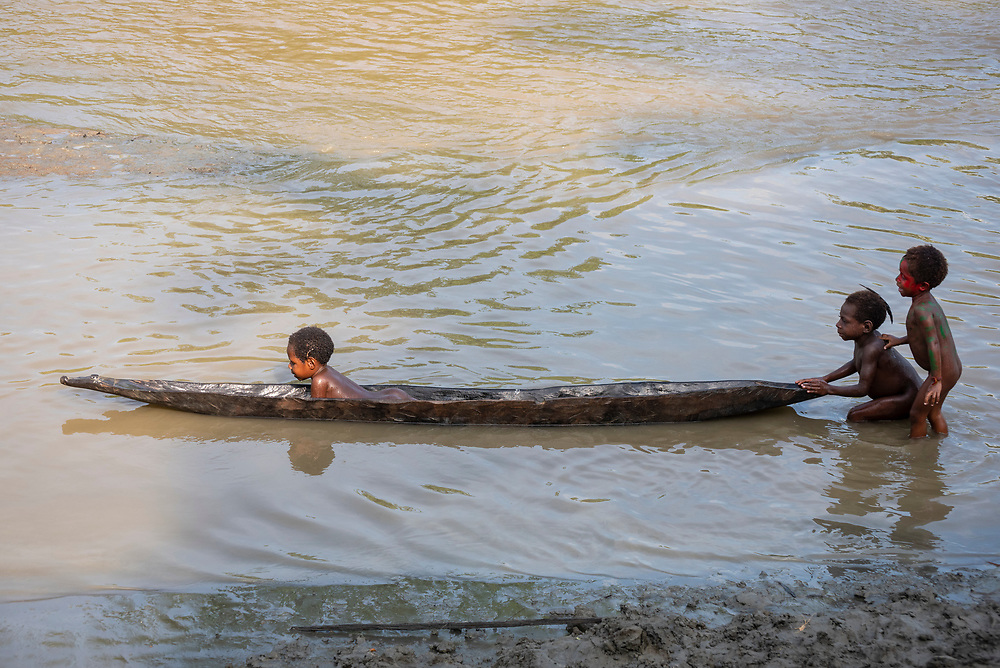 Children play with a dugout canoe in Yar village, located on the Keram River in Papua New Guinea's East Sepik Province. (Jun 21, 2019)