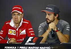 July 27, 2017 - Budapest, Hungary - Motorsports: FIA Formula One World Championship 2017, Grand Prix of Hungary, ..#5 Sebastian Vettel (GER, Scuderia Ferrari), #14 Fernando Alonso (ESP, McLaren Honda) (Credit Image: © Hoch Zwei via ZUMA Wire)