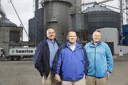 SHOT 10/29/18 9:48:01 AM - Sunrise Cooperative is a leading agricultural and energy cooperative based in Fremont, Ohio with members spanning from the Ohio River to Lake Erie. Sunrise is 100-percent farmer-owned and was formed through the merger of Trupointe Cooperative and Sunrise Cooperative on September 1, 2016. Photographed at the Clyde, Ohio grain elevator was George D. Secor President / CEO and John Lowry<br /> Chairman of the Board of Directors with  CoBank RM Gary Weidenborner. (Photo by Marc Piscotty © 2018)