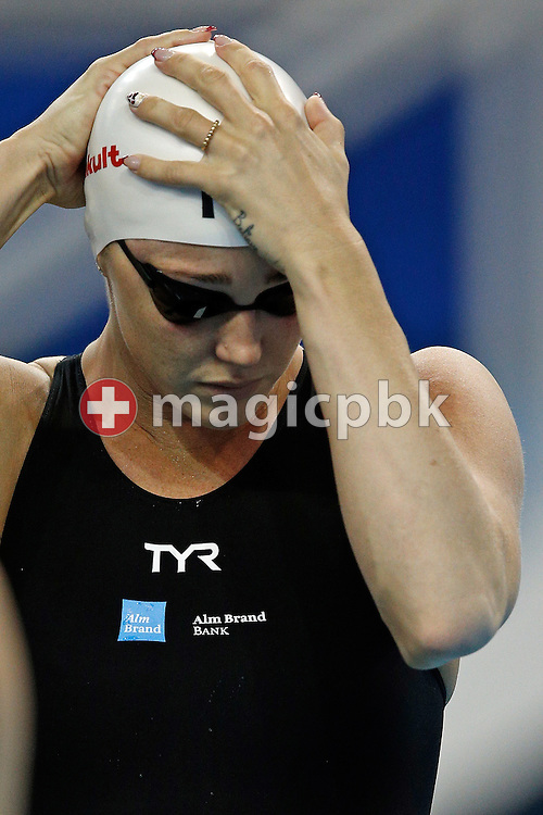 Jeanette OTTESEN of Denmark prepares herself before competing in the women's 100m Butterfly Heats during the 12th Fina World Short Course Swimming Championships held at the Hamad Aquatic Centre in Doha, Qatar, Saturday, Dec. 6, 2014. (Photo by Patrick B. Kraemer / MAGICPBK)
