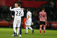 Swansea city manager Paul Clement celebrates with goal scorer Gylfi Sigurdsson of Swansea city at the end of the game after they win 2-1. Premier league match, Swansea city v Southampton at the Liberty Stadium in Swansea, South Wales on Tuesday 31st January 2017.<br /> pic by  Andrew Orchard, Andrew Orchard sports photography.