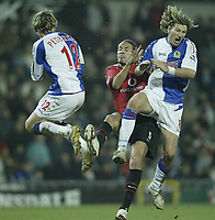 Photo: Aidan Ellis.<br /> Blackburn v Manchester United. Barclays Premiership. 01/02/2006.<br /> United's Rio Ferdinand challenges Blackburn's Robbie Savage and is sent off for the challenge