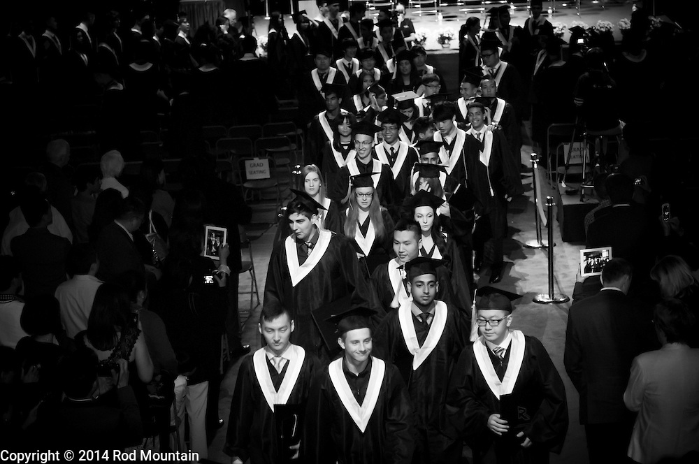 The scene as captured during a high school graduation ceremony at the Bill Copeland Sports Centre. Burnaby, BC<br /> <br /> Photo: © Rod Mountain
