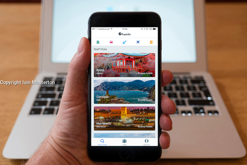 Using iPhone smartphone to display homepage of Expedia travel booking website
