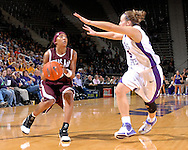 Texas A&M guard Takia Starks (R) drives against pressure from Kansas State defender Kimberly Dietz (R) in the first half at Bramlage Coliseum in Manhattan, Kansas, January 6, 2007.  K-State upset the 17th ranked Aggies 48-45.