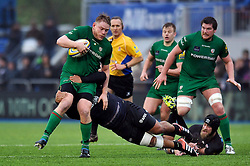 Tom Court of London Irish takes on the Saracens defence - Photo mandatory by-line: Patrick Khachfe/JMP - Mobile: 07966 386802 03/01/2015 - SPORT - RUGBY UNION - London - Allianz Park - Saracens v London Irish - Aviva Premiership