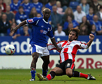 Fotball<br /> England <br /> Foto: SBI/Digitalsport<br /> NORWAY ONLY<br /> <br /> <br /> Leicester City v Southampton. Coca Cola Championship. 14/10/2006.<br /> Claus Lundekvam slides in on  Elvis Hammond.