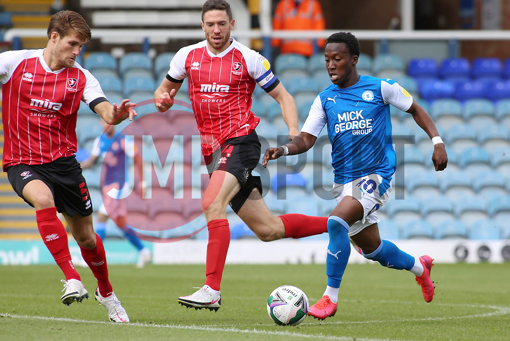 Siriki Dembele of Peterborough United takes on Ben Tozer and Charlie Raglan of Cheltenham Town - Mandatory by-line: Joe Dent/JMP - 05/09/2020 - FOOTBALL - Weston Homes Stadium - Peterborough, England - Peterborough United v Cheltenham Town - Carabao Cup