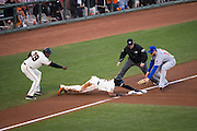 San Francisco Giants third base coach Roberto Kelly (39) reacts to a stolen third base by center fielder Denard Span (2) during Game 4 of the NLDS against the Chicago Cubs at AT&T Park in San Francisco, Calif., on October 11, 2016. (Stan Olszewski/Special to S.F. Examiner)