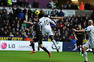 Swansea city's Wilfried Bony © scores his sides 1st goal to equalise at 1-1. Barclays Premier league, Swansea city v Manchester City at the Liberty Stadium in Swansea,  South Wales on  New years day Wed 1st Jan 2014 <br /> pic by Andrew Orchard, Andrew Orchard sports photography.