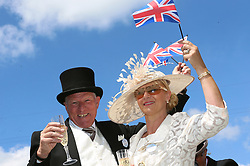 Peter Caunce (left) and Debbie Caunce wave Union Jack flags during day three of Royal Ascot at Ascot Racecourse.