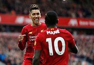 Roberto Firmino of Liverpool celebrates with scorer Sadio Mane of Liverpool  during the Premier League match at Anfield, Liverpool. Picture date: 7th March 2020. Picture credit should read: Darren Staples/Sportimage